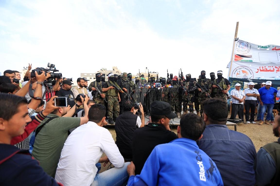 الأذرع العسكرية لفصائل المقاومة الفلسطينية خلال مؤتمر صحفي في غزة (39191057) 