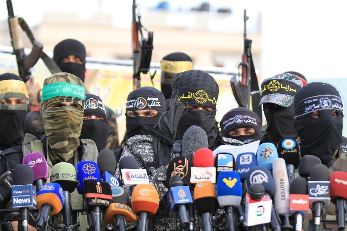الأذرع العسكرية لفصائل المقاومة الفلسطينية خلال مؤتمر صحفي في غزة (39191046) 