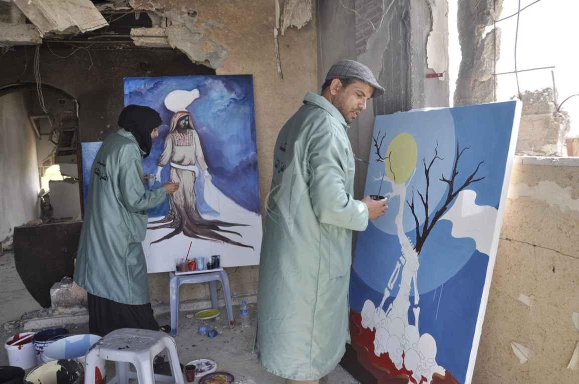 منتدى الفن التشكيلي ينظم تضاهرة فنية في ذكرى يوم الأرض على ركام بيوت خزاعة المدمرة شرق خانيونس - (269135938) 