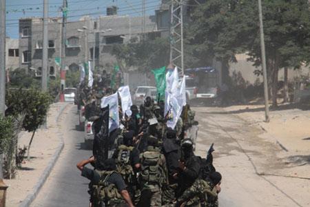 العرض العسكري لكتائب القسام المقاومة 203ac030f0addcd6b446