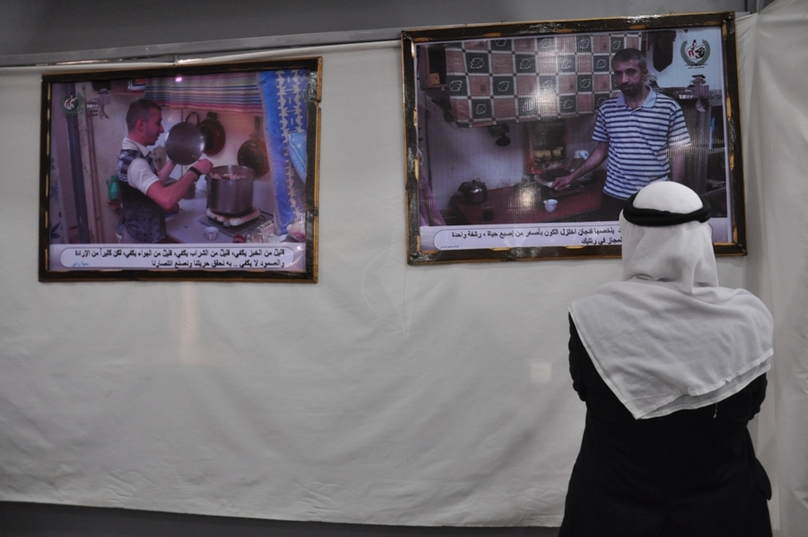 بالصور ..ثقافة غزة تقييم معرضاً للصور وسط المدنية